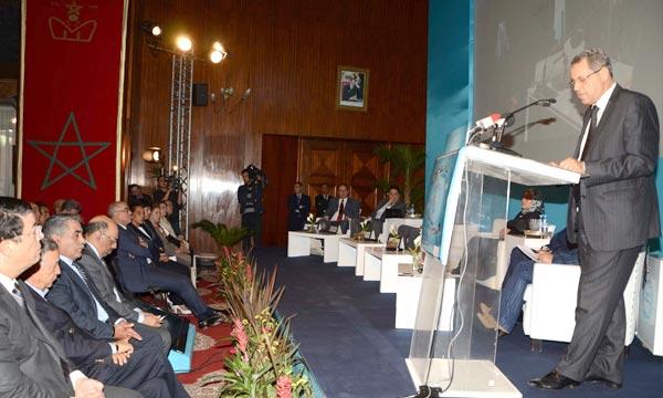 Le ministre de l'intérieur, Mohand Laenser, intervenant, à Casablanca, lors de l'ouverture  des  travaux d'une rencontre nationale organisée à l'occasion du 8e anniversaire de l'INDH. (Photo : Hihi)