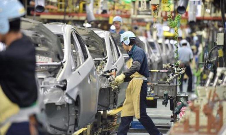 Des ouvriers sur une chaîne de montage dans une usine Toyota à Aichi au Japon . Ph : AFP