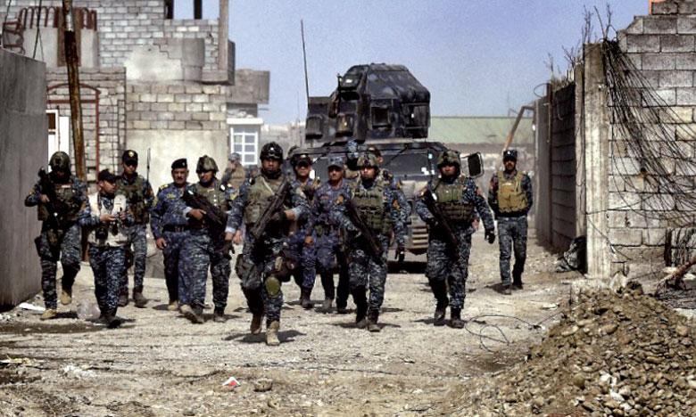 Les forces irakiennes dans une rue de Mossoul lors de leur offensive pour prendre la ville aux jihadistes de l'EI, le 26 février2017.                    Ph. AFP