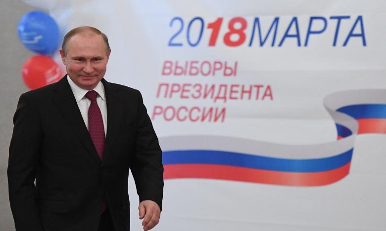 Avec plus de 56 millions de voix, Vladimir Poutine est arrivé très loin devant ses adversaires avec une participation supérieure à la présidentielle de 2012.                                                                                                                                          Ph. Reuters