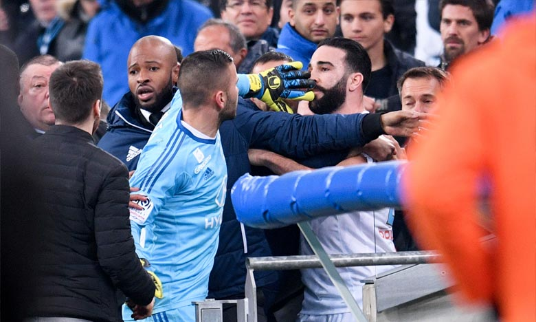 Suite aux incidents à l'issue du match Marseille-Lyon le 18 mars, la commission de discipline de la LFP a infligé trois matches de suspension à Anthony Lopes et Adil Rami. Ph : AFP