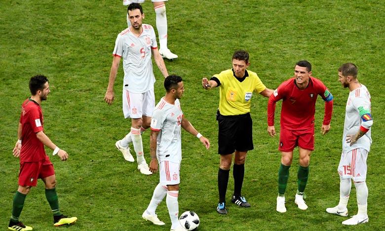 L'arbitre italien Gianluca Rocchi, durant, le match Portugal-Espagne «3-3», à Sotchi, . Ph : AFP