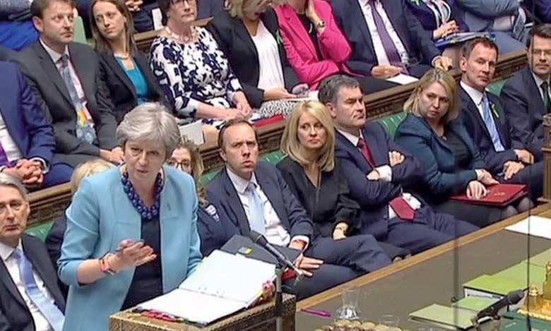 La Première ministre Theresa May a mis en garde les députés, europhiles comme eurosceptiques,  qui seraient tentés d'amender les deux projets de loi sur le Brexit.                                                                Ph. AFP