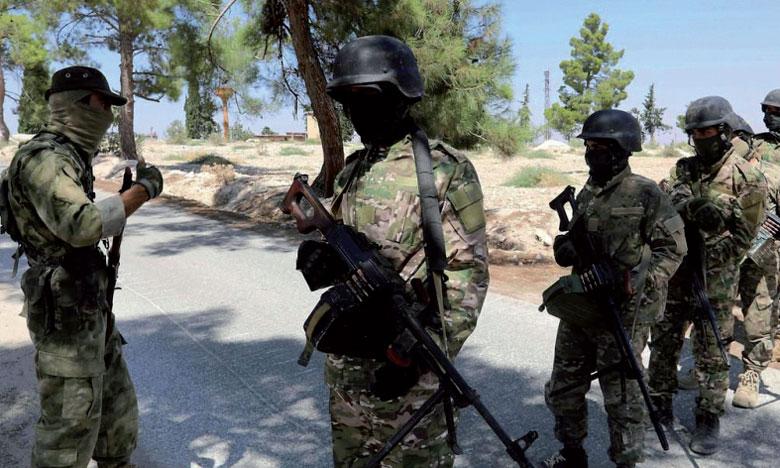 Des combattants rebelles syriens se préparent à une offensive des forces gouvernementales, aux abords de Idlib où habitent  3 millions de personnes.                                                                                                                                                                                                     Ph. AFP