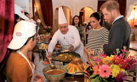 Le Prince Harry et son épouse assistent  à une démonstration culinaire en présence d'enfants défavorisés et aux besoins spécifiques