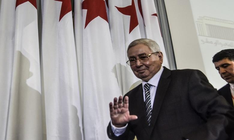 Cette décision est conforme à ce que prévoit la Constitution, mais va à l'encontre de ce que réclament les Algériens. Ph. AFP