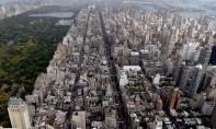 Les milliers de bâtiments résidentiels et commerciaux de plus de 2.300 m2 concernés par le texte représentent près du tiers des émissions de la ville. Ph :  AFP