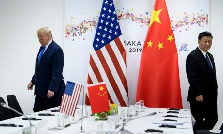 Le président américain Donald Trump et son homologue chinois Xi Jinping au début de leur rencontre en marge du sommet G20 d'Osaka. Ph :  AFP