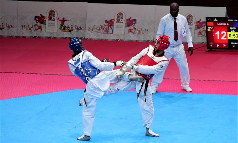 Le taekwondoïste marocain a décroché la médaille au terme de sa victoire en finale face à l'Ivoirien Issa Diakite (médaille d'argent) sur le score de 28 à 16. Ph : MAP