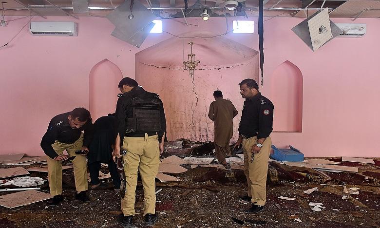 Des éléments de la police pakistanaise examinant le site d'une autre explosion qui s'est produite le 24 mai 2019 dans une mosquée de la banlieue de Quetta. Ph. AFP/Archives