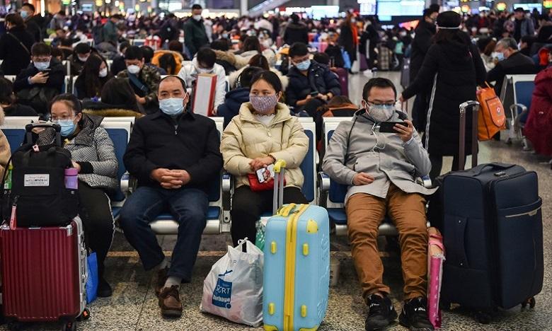 Face à l'épidémie, la Chine confine des villes et ferme la Cité interdite
