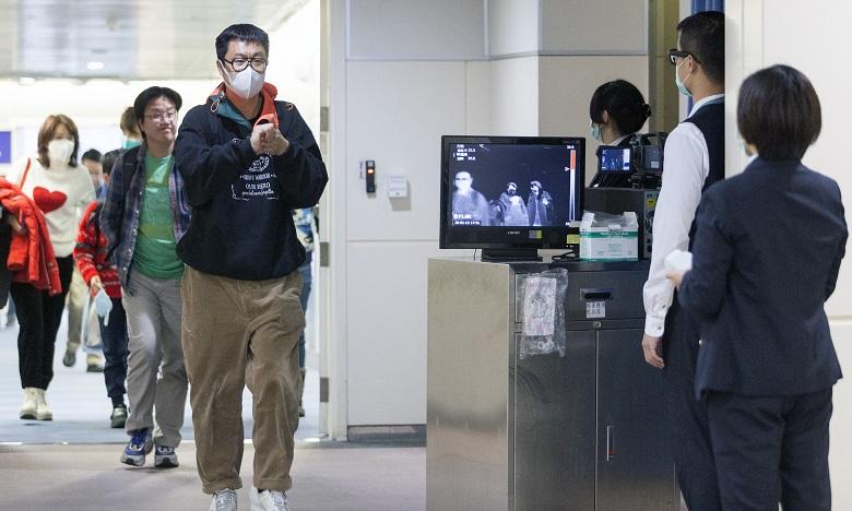 Les autorités thaïlandaises ont mis en place des détections thermiques obligatoires dans les aéroports pour les passagers en provenance des zones chinoises à risques. Ph. AFP