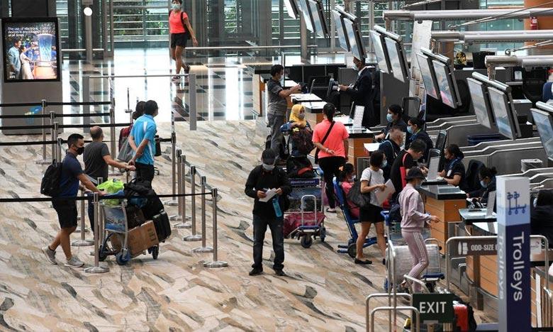 Une puce électronique GPS et Bluetooth sera remise à certains arrivants dans le pays, qu'ils soient touristes, résidents et citoyens, l'objectif est de s'assurer que les touristes respectent les consignes. Ph : AFP