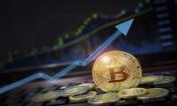 Le bitcoin remonte à 60.000 $ et se rapproche de son record historique